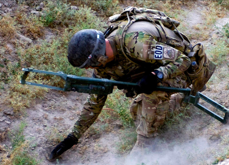 Military personnel using Stratom tool