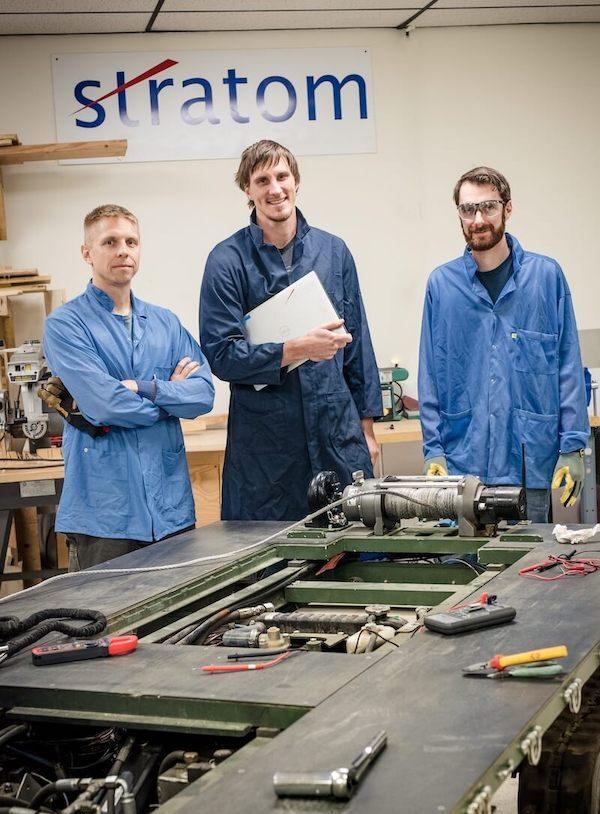 Stratom engineers in workshop