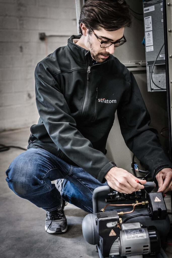 Stratom engineer working on mechanics