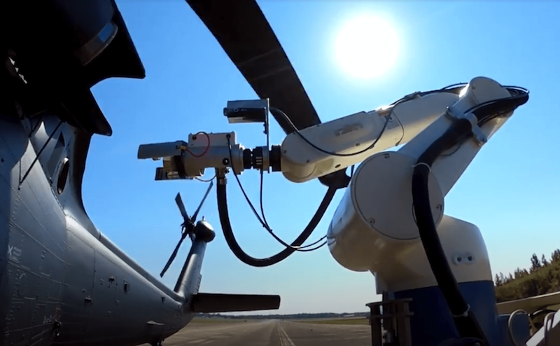 Stratom robotic arm refueling helicopter