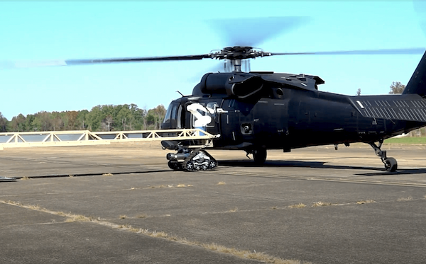 full view of robotic arm refueling helicopter